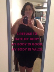 "Picture of me, a fat woman, taking a selfie in a mirror, text overlay reads ""I refuse to hate my body. My body is good. My body is valid."""